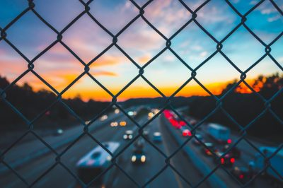 Chattanooga Tennessee Smart City view of cars on highway through fence