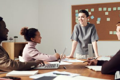Image of woman leading a team in a meeting