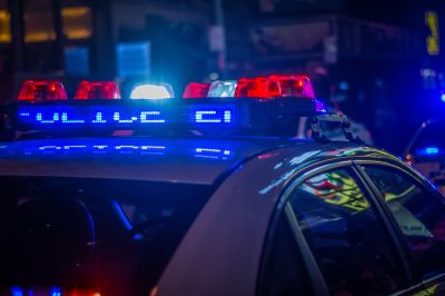 police sirens lit up on a police car
